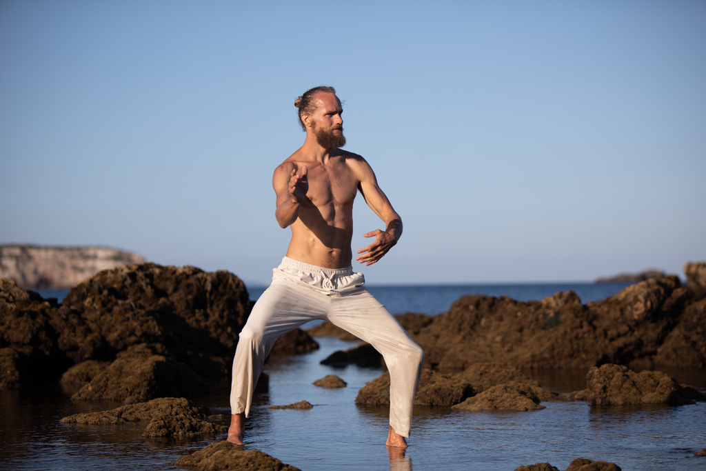 Breathwork wide stance standing pose in water